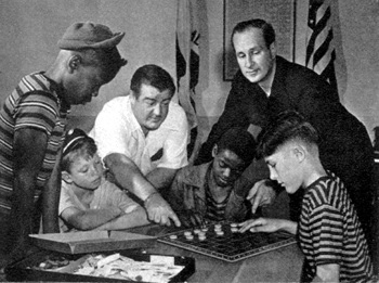 Behind the dignified entrance to the Costello Youth Foundation, hundreds of kids learn how to have all kinds of fun -- often, as in the checker game, under the expert tutelage of President Lou Costello and Secretary Bud Abbott.