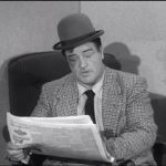 Lou Costello reading a newspaper in Wife Wanted