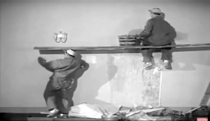 Lou Costello is about to pull the board out from under Bud Abbott